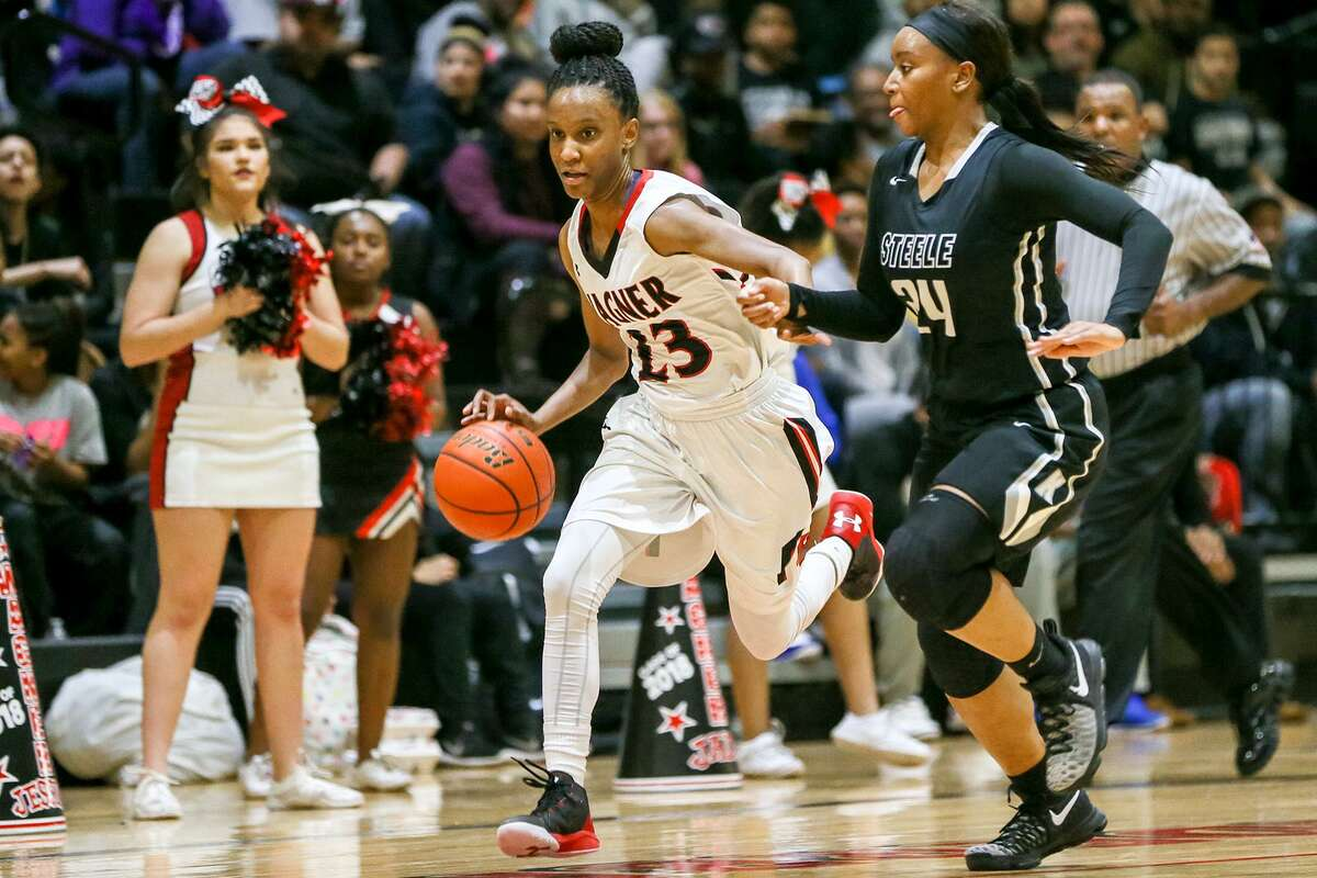 Wagner's Kiana Williams (left) takes off on a fast break with Steele's Kayla Payne in pursuit during a District 27-6A game on Dec. 16, 2016.