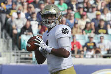 JACKSONVILLE, FL - NOVEMBER 05:  DeShone Kizer #14 of the Notre Dame Fighting Irish attempts a pass during the game against the Navy Midshipmen at EverBank Field on November 5, 2016 in Jacksonville, Florida.  (Photo by Sam Greenwood/Getty Images)