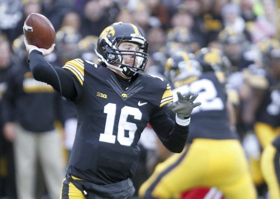 IOWA CITY, IA- NOVEMBER 25:  Quarterback C.J. Beathard #16 of the Iowa Hawkeyes drops back to throw a pass in the first quarter against  the Nebraska Huskers, on November 25, 2016 at Kinnick Stadium in Iowa City, Iowa.  (Photo by Matthew Holst/Getty Images) Photo: Matthew Holst/Getty Images