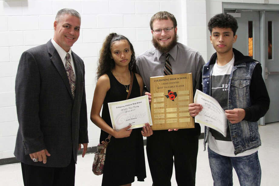 Coldspring-Oakhurst High School Cross Country MVPs Destiny Thompson and Fernando Martinez, shown with Athletic Director Mark Byrd, left, and Cross Country Coach Wesley Schultz, were honored at the COHS Fall Athletic Banquet 2016-17 on Wednesday, Jan. 11. Photo: Submitted