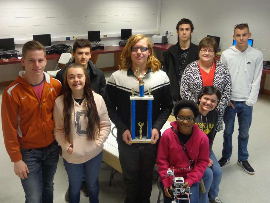 Members of the COHS Robotics Team show off their 1st place trophy, won at theRegion 6 Advanced Arena LEGO Robotics competition on Saturday,Jan. 7. The team will go on to compete at the state level in April. Pictured from left to right, are (back row)Kyle Buchanan, teacher and sponsor Laura Everett, and Mason Watson; (front row) Jimmie Gann, Meghan Wright, Jared Siegfried, Lead Programmer Dustin Welch, Charise Lincoln and Faith Villa. Photo: Submitted