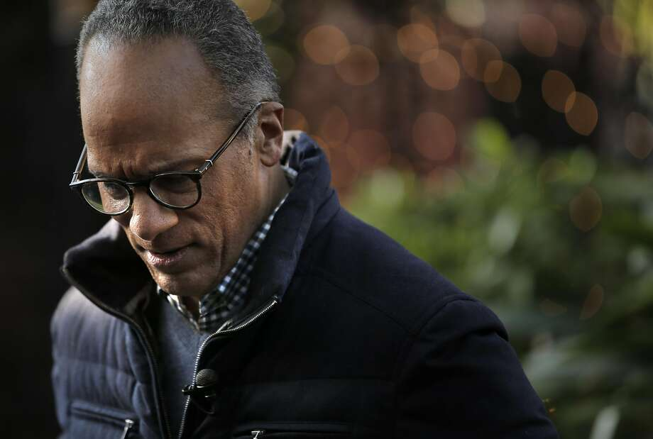 Lester Holt pauses as he chats with KCRA anchor Kellie DeMarco at Firehouse Restaurant. Photo: Carlos Avila Gonzalez, The Chronicle