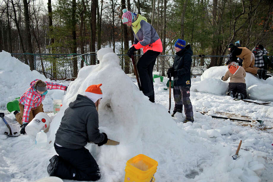 BRITTNEY LOHMILLER | blohmiller@mdn.net Students from Midland High and Meridian work on their snow sculptures at City Forest Friday morning during the 40th annual Midland Public Schools snow sculpture contest. The students began work on their sculptures at 8 a.m. and had until 1 p.m. to complete them for judging.