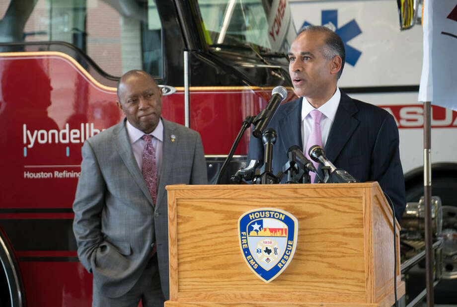 Houston Mayor Sylvester Turner, left, listens as LyondellBasell CEO Bob Patel announces the company's donation to area fire departments for hazardous materials training. (Contributed photo)