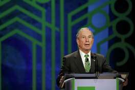 FILE - In this Thursday, Dec. 1, 2016 file photo, former New York City Mayor Michael Bloomberg announces award nominees during the C40 Cities Award presentation in Mexico City. The eight individuals who own as much as half of the rest of the planet are all men, and have largely made their fortunes in technology. Bloomberg created the eponymous financial information provider in 1981 after getting laid off from an investment bank and made it a lucrative business in particular by selling data terminals to financial services firms. (AP Photo/Rebecca Blackwell, file)
