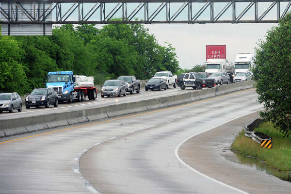 An accident involving two tractor trailers closed down Interstate 10 near 11th Street Monday morning. Traffic was temporarily diverted at Walden Road and Fannett Road while crews removed rocks flung onto the road from one of the trucks.  Photo taken Monday, April 25, 2016 Guiseppe Barranco/The Enterprise