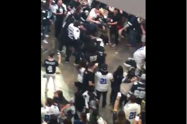Filming from the floor above, Alex (@alexxvx_2897) caught video of melee below. Event staff was nearby and the fight was quickly dispersed and a Packers jersey-clad man was pulled from a pack of Cowboys fans.
