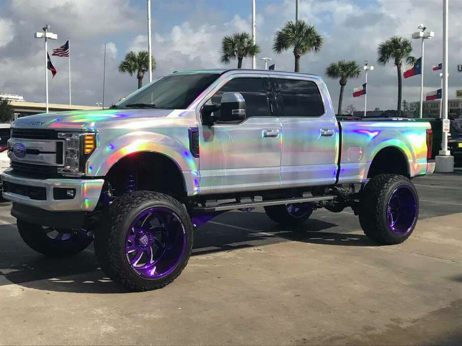 Tire and Wheel Master, based in Houston, is selling a lifted Ford Super Duty 250 that looks like it was designed by Lisa Frank for $100,000. Photo: Trey Roedy