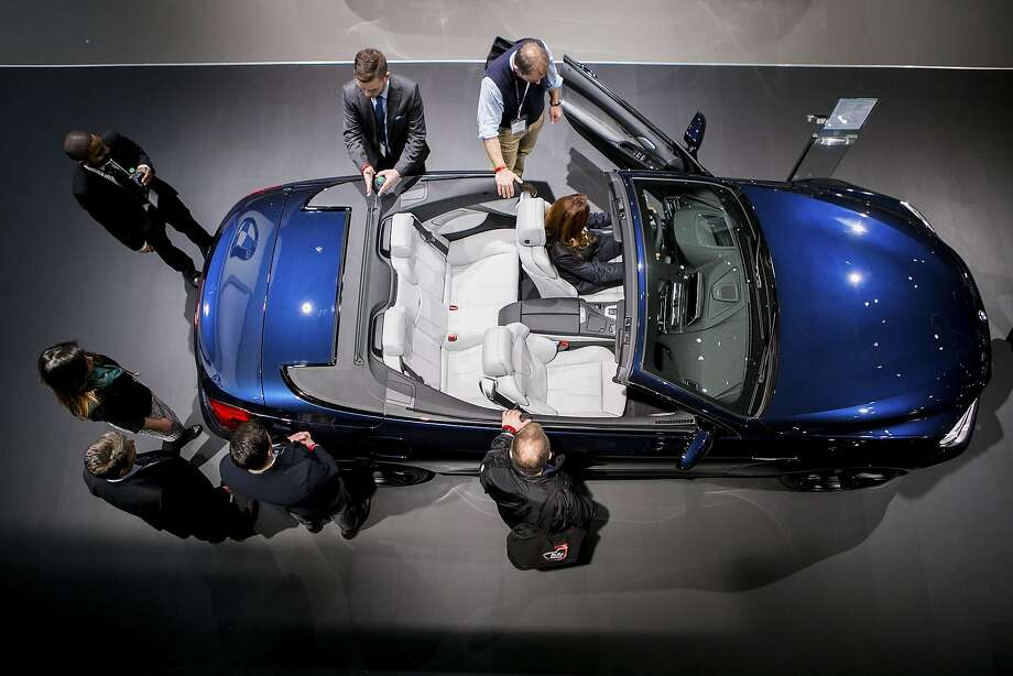 FILE -- Attendees check out the BMW M6 convertible during the New York International Auto Show at the Javits Convention Center, in New York, March 24, 2016. President-elect Donald Trump has criticized Mercedes-Benz and BMW for plans to build a plant in Mexico, but the globalized trade in vehicles, in which Detroit owns European brands and German cars come from Alabama, could make it hard to raise barriers. (Sam Hodgson/The New York Times) Photo: SAM HODGSON, NYT