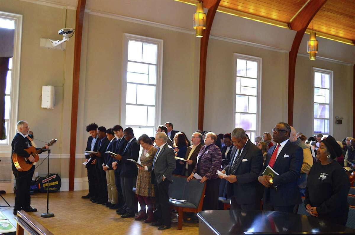 """The congregation joins in singing """"Amazing Grace"""" at the Interfaith Council of New Canaan's Service of Remembrance for Martin Luther King Day, Monday, Jan. 16, 2017, at the United Methodist Church in New Canaan, Conn."""