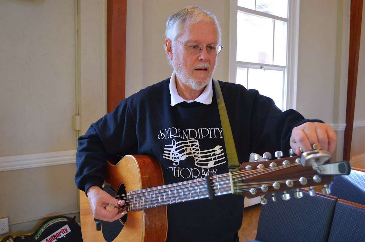 Bruce Taylor of Weston tunes his guitar before performing for the Interfaith Council of New Canaan's Service of Remembrance for Martin Luther King Day, Monday, Jan. 16, 2017, at the United Methodist Church in New Canaan, Conn.