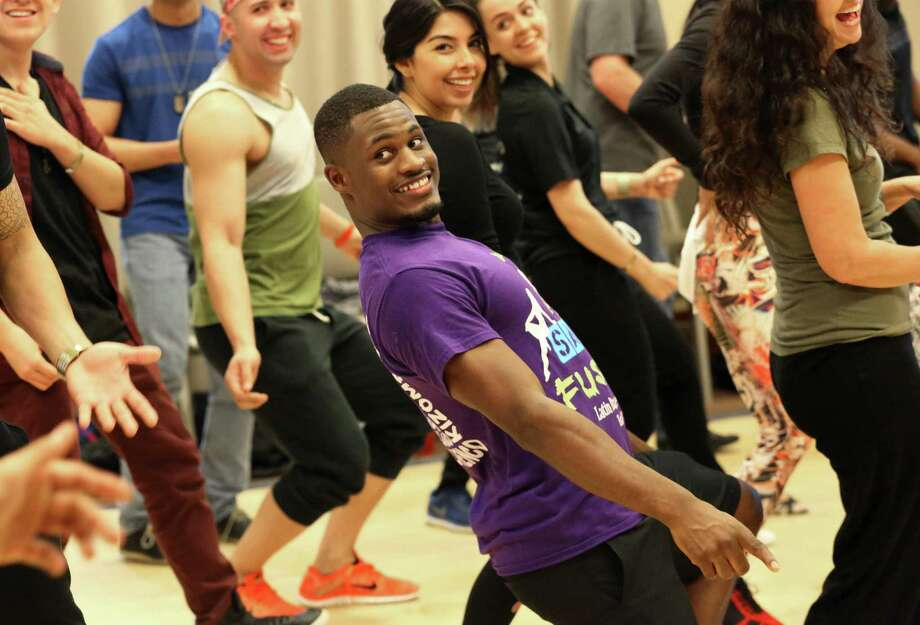 Houston Salsa Congress workshop participant Harrison Bohanan follows instructor Franklin Liranzo's dance moves to warm up before a classSaturday, Jan. 14, 2017, in Houston.  ( Yi-Chin Lee / Houston Chronicle ) Photo: Yi-Chin Lee, Staff / Houston Chronicle / © 2017  Houston Chronicle