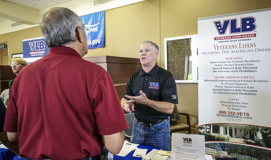 "Steve Hudson, a marketing specialist at Texas Veterans Land Board, provides a veteran with information on state programs including land, housing and home improvement loans Saturday afternoon during a free ""come and go"" benefit fair at the Laredo VA Outpatient Clinic. Photo: Victor Strife, Staff Photographer / Laredo Morning Times"