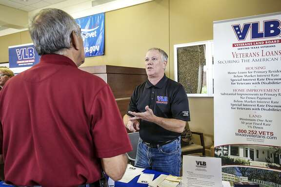 "Steve Hudson, a marketing specialist at Texas Veterans Land Board, provides a veteran with information on state programs including land, housing and home improvement loans Saturday afternoon during a free ""come and go"" benefit fair at the Laredo VA Outpatient Clinic."