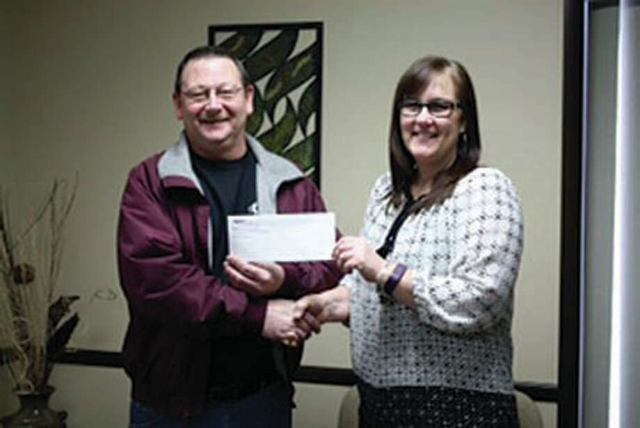A local business aided by a group of exceptional community volunteers recently donated a charitable contribution to United Hospice Service (UHS) of Marlette Regional Hospital. Over the course of many months, Eddie G's restaurant has hosted a very popular Burger and Bike Night and euchre tournament where a portion of the proceeds and a 50/50 raffle has benefitted the local hospice program. Special thanks are extended to volunteers Leslie and Roger Ballard, Brad and Bonnie Firmingham, the Eddie G's staff, Ryan Lambert, and Mikkel Creason for their help in making these events and fundraisers successful. Pictured, on behalf of Eddie G's, co-owner Eddie Gerstenberger presents UHS Director Shelli Greschaw with a donation of $2,000 that will be used to financially assist patients with their hospice care. (Submitted photo)