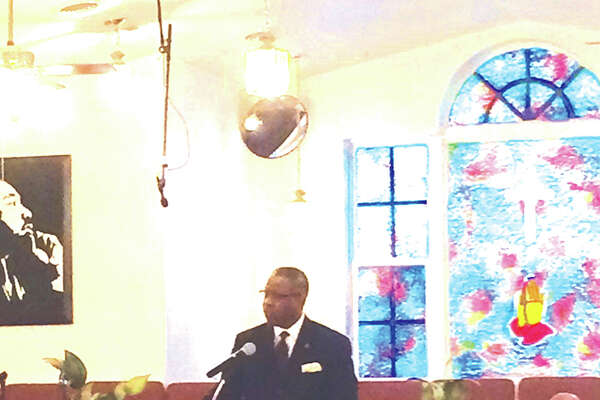 Troy Benton, pastor at St. John's United Methodist Church, speaks Monday morning during the annual Martin Luther King Day celebration at Mt. Joy Missionary Baptist Church in Edwardsville.