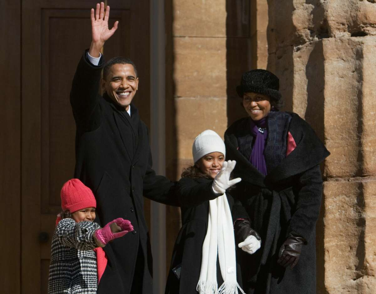 Presidential hopeful US Senator Barack Obama, accompanied by his wife Michelle (R) and their daughters Sasha (L), 5, and Malia, 8, waves 10 February, 2007 from the steps of the Old State Capitol in Springfield, Illinois, at the end of a rally. Obama officially launched his quest to become the first African-American president of the US.