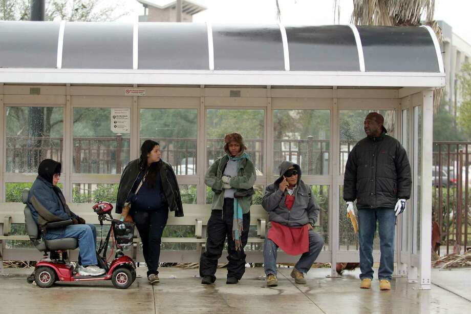 Metro users attempt to stay warm while waiting for a bus at the Wheeler station on Jan. 6. Wheeler is among a handful of transit stops where Metro has received complaints of loitering and drug use, which gives people a negative perception of the service. Photo: J. Patric Schneider, For The Chronicle / © 2017 Houston Chronicle