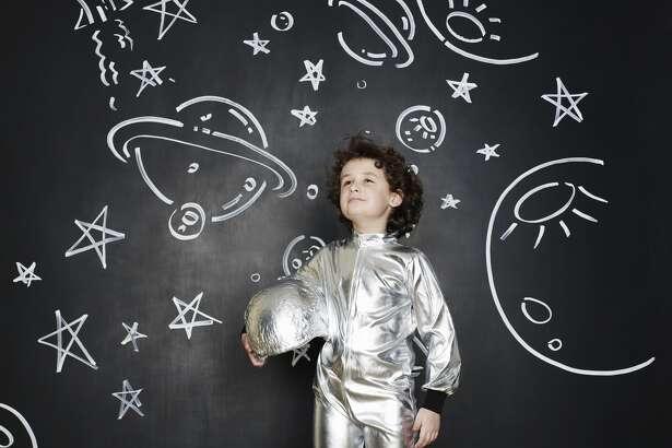 Boy dressed as an astronaut   Credit: Flashpop
