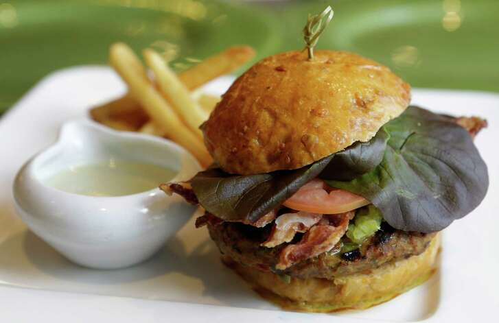 A bison burger is shown at Kiran's, 2925 Richmond, Monday, Jan. 16, 2017, in Houston.