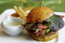 A bison burger is shown at Kiran's, 2925 Richmond, Monday, Jan. 16, 2017, in Houston.