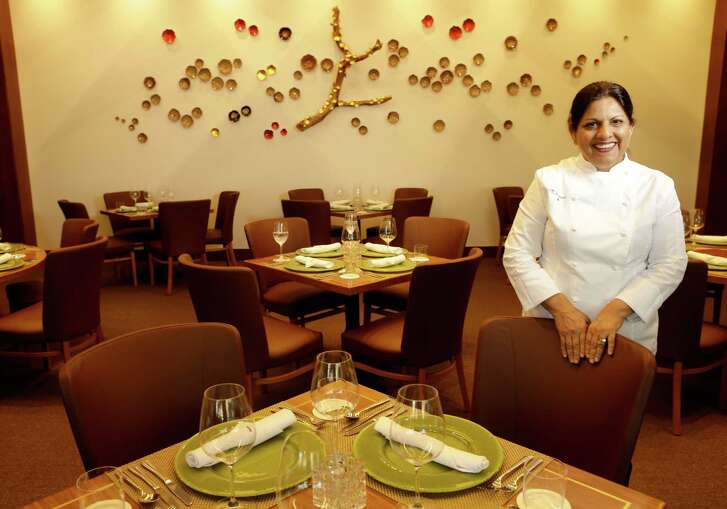 Chef Kiran Verma poses in the dining room at Kiran's, 2925 Richmond, Monday, Jan. 16, 2017, in Houston.
