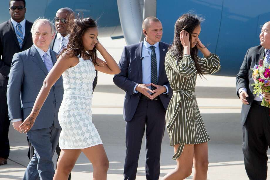 MADRID, SPAIN - JUNE 29:  (L-R) Sasha Obama and Malia Obama arrive at Torrejon Air Force Base on June 29, 2016 in Madrid. The First Lady will deliver a speech on Let Girls Learn to girls and young women, sharing the stories of girls she has met in her prior travels and highlighting new commitments to support Let Girls Learn. Mrs. Obama will encourage the audience to value their own educational opportunities, continue to strive for progress for girls and young women in their country, and take action to help the more than 62 million girls around the world who are out of school, 2016 in Madrid, Spain.  (Photo by Pablo Cuadra/Getty Images) Photo: Pablo Cuadra/Getty Images
