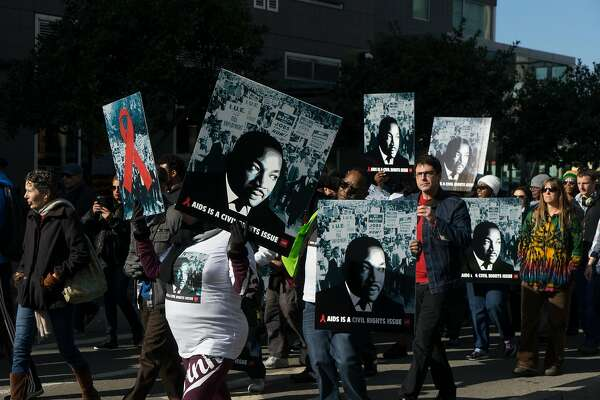 Marchers make their way to Yerba Buena Gardens from 4th and King in San Francisco, Calif.  on Monday, Jan. 16, 2016. In honor of Martin Luther King Jr.'s birthday, people marched from 4th and King to Yerba Buena Gardens for an afternoon of speeches and movies.