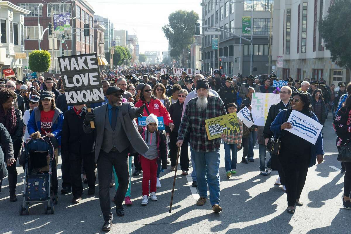 Marchers make their way to Yerba Buena Gardens in San Francisco, Calif. on Monday, Jan. 16, 2016. In honor of Martin Luther King Jr.'s birthday, people marched from 4th and King to Yerba Buena Gardens for an afternoon of speeches and movies.