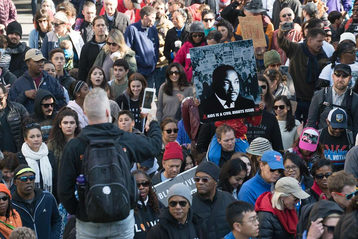 Marchers make their way into Yerba Buena Gardens in San Francisco, Calif. on Monday, Jan. 16, 2016. In honor of Martin Luther King Jr.'s birthday, people marched from 4th and King to Yerba Buena Gardens for an afternoon of speeches and movies.