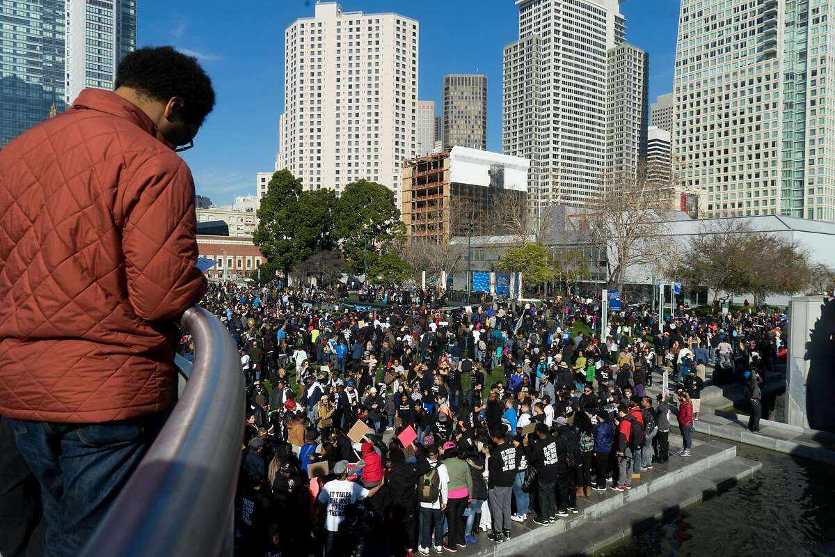 People gather in Yerba Buena Gardens to listen to speeches in San Francisco, Calif. on Monday, Jan. 16, 2016. In honor of Martin Luther King Jr.'s birthday, people marched from 4th and King to Yerba Buena Gardens for an afternoon of speeches and movies.