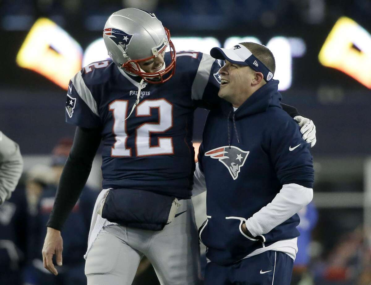New England Patriots quarterback Tom Brady (12) and offensive coordinator Josh McDaniels walk together during warm-ups before an NFL divisional playoff football game against the Houston Texans, Saturday, Jan. 14, 2017, in Foxborough, Mass. (AP Photo/Elise Amendola)