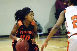 Edwardsville freshman point guard Quierra Love runs the offense during Sunday's game against Chicago Whitney Young at the MLK Shootout in St. Louis.