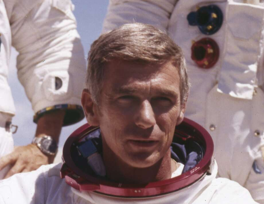 FILE - In an undated file photo provided by NASA, US  Navy Commander and Astronaut for the upcoming Apollo 17, Eugene Cernan, is pictured in his space suit. NASA announced that former astronaut Cernan, the last man to walk on the moon, died Monday, Jan. 16, 2017, surrounded by his family. He was 82.  (NASA via AP) Photo: AP, Associated Press