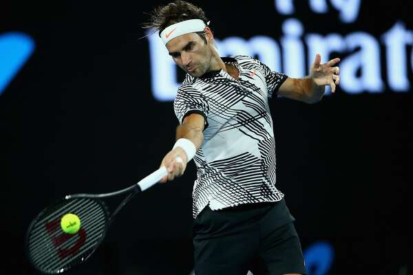 MELBOURNE, AUSTRALIA - JANUARY 16:  Roger Federer of Switzerland plays a forehand in his first round match against Jurgen Melzer of Austria on day one of the 2017 Australian Open at Melbourne Park on January 16, 2017 in Melbourne, Australia.  (Photo by Clive Brunskill/Getty Images)