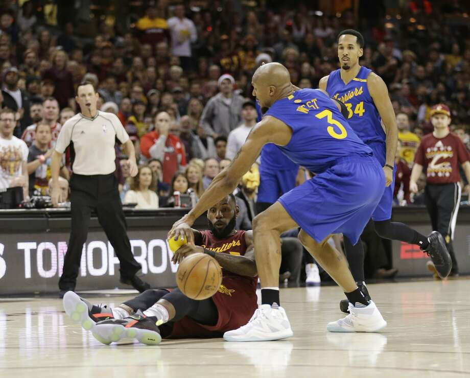 Cleveland Cavaliers' LeBron James passes against Golden State Warriors' David West, right, in the first half of an NBA basketball game, Sunday, Dec. 25, 2016, in Cleveland. (AP Photo/Tony Dejak) Photo: Tony Dejak, Associated Press