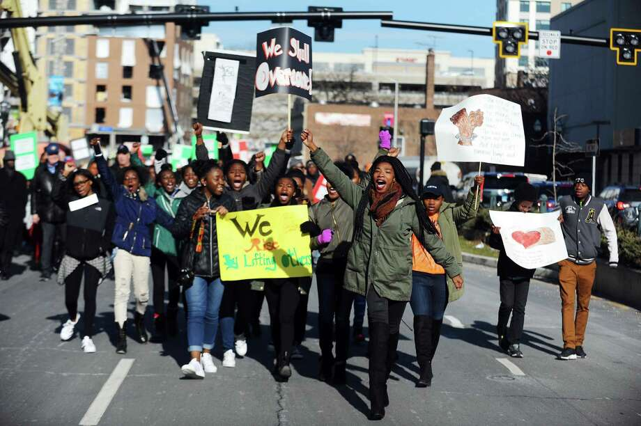 Kathleen Charles, 18, of Stamford, center right, leads a cheer during the annual Martin Luther King Jr. Day march in Stamford on Monday. Photo: Michael Cummo / Hearst Connecticut Media / Stamford Advocate