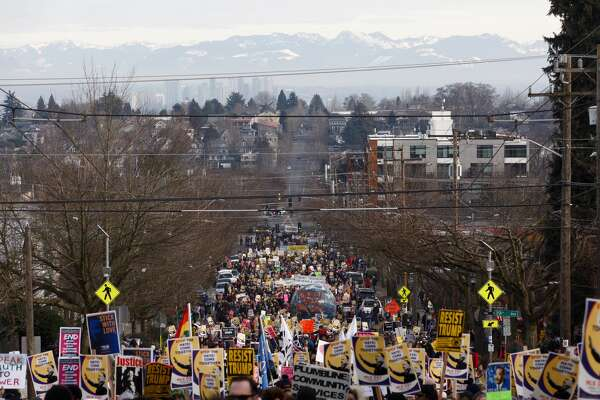 Thousands of marcher took to the streets for Martin Luther King Jr. Day celebrations, Monday, January 16, 2017. The march began at Garfield High School and concluded at the Henry M. Jackson Federal Building in downtown Seattle.