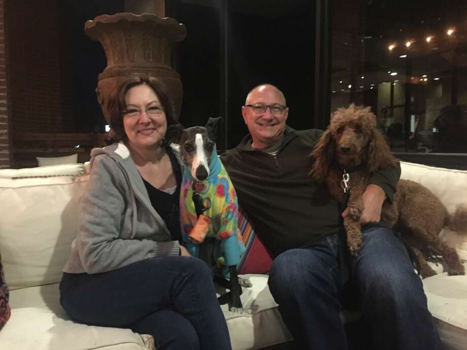 Brew Street:  Julie and Paul Hooper with their dogs, Lily and Meg Photo: Courtesy Photo