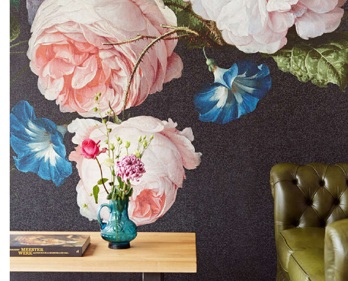 JFFabrics' Antiquity vinyl wallcovering boasts a larger-than-life bouquet of colorful blooms.