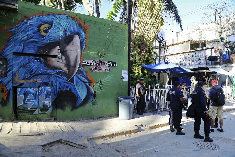 Police officers patrol outside the entrance of the Blue Parrot nightclub in Playa del Carmen, Mexico. Photo: Associated Press
