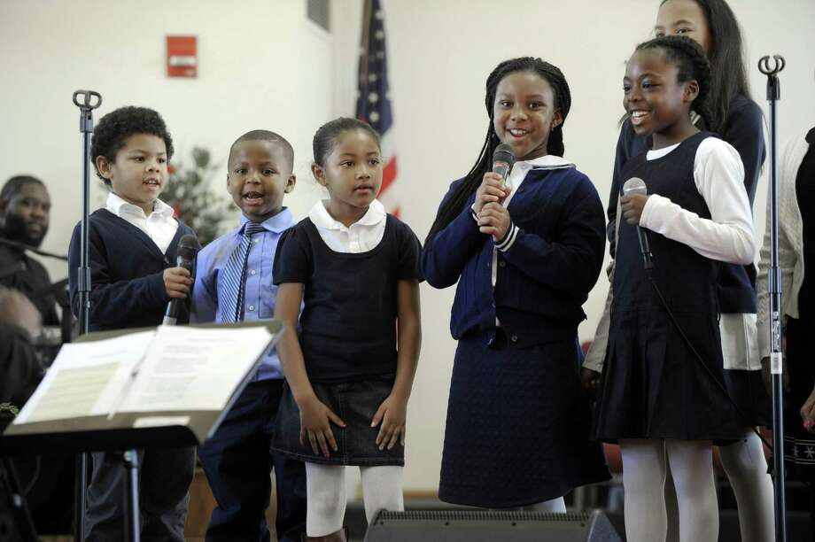 Children in the Sounds of Joy youth choir, including from left, Milo Moffett, Maceo Baker III, Jasmine King , Jahnia Brown and Anaiah Ebron-Williams perform a song honoring Dr. Martin Luther King Jr. New Hope Baptist Church in Danbury remembers the legacy of Dr. Martin Luther King Jr. Monday, January 16, 2017, the national holiday honoring the birthday of the civil rights leader. Photo: Carol Kaliff / Hearst Connecticut Media / The News-Times