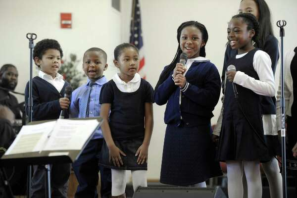 Children in the Sounds of Joy youth choir, including from left, Milo Moffett, Maceo Baker III, Jasmine King , Jahnia Brown and Anaiah Ebron-Williams perform a song honoring Dr. Martin Luther King Jr. New Hope Baptist Church in Danbury remembers the legacy of Dr. Martin Luther King Jr. Monday, January 16, 2017, the national holiday honoring the birthday of the civil rights leader.