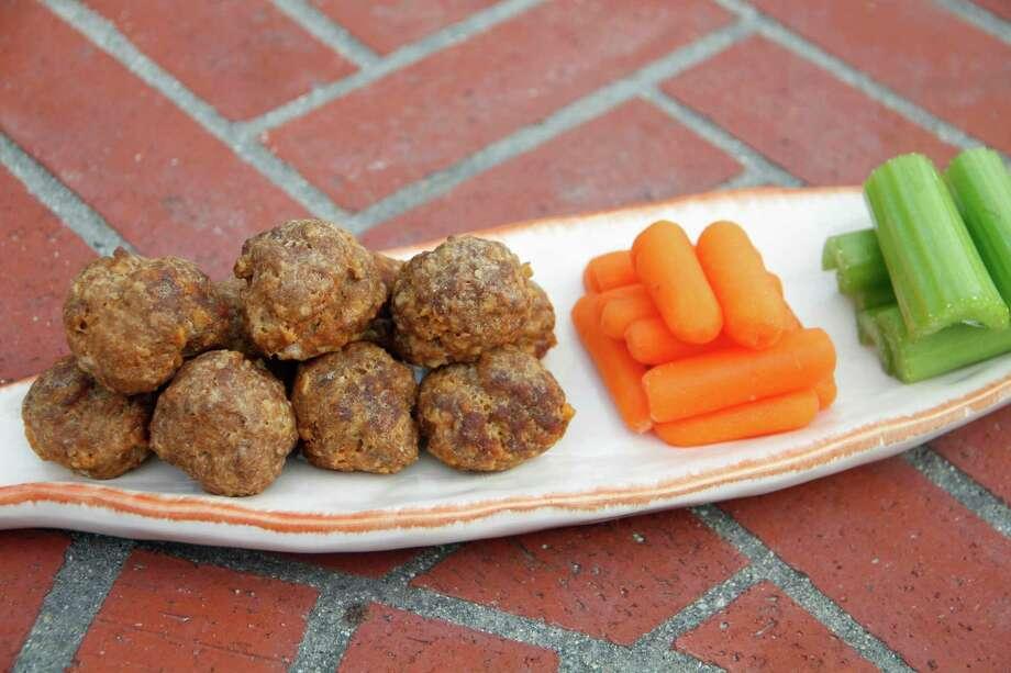 Use an ice cream scoop to form these Buffalo-Style Meatballs. Photo: Melissa D'Arabian, UGC / Melissa d'Arabian