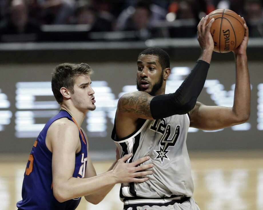 Phoenix Suns' Dragan Bender challenges the Spurs' LaMarcus Aldridge for the ball in the second half in Mexico City on Jan. 14, 2017. Photo: Rebecca Blackwell /Associated Press / Copyright 2016 The Associated Press. All rights reserved. This material may not be published, broadcast, rewritten or redistribu