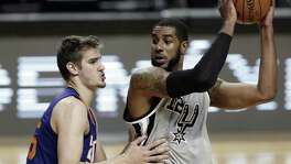 Phoenix Suns Dragan Bender challenges the Spurs' LaMarcus Aldridge in the second half of their regular-season game in Mexico City on Jan. 14, 2017.