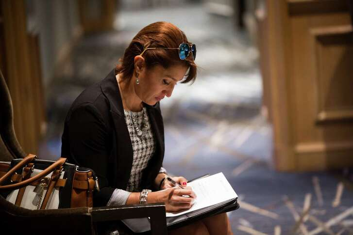 Ariana Gonzalez prepares for an interview at a job fair for Yauatcha, a restaurant set to open in the Galleria from international hospitality powerhouse Hakkasan Group.