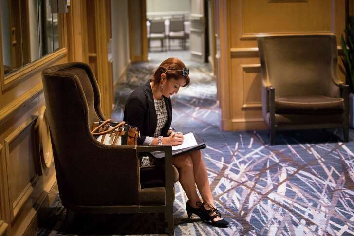 Ariana Gonzalez fills up paperwork before a job interview at the Yauatcha job fair, Tuesday, Dec. 6, 2016, in Houston. Gonzalez has experience in human resources but is seeking a job in middle management. ( Marie D. De Jesus / Houston Chronicle )