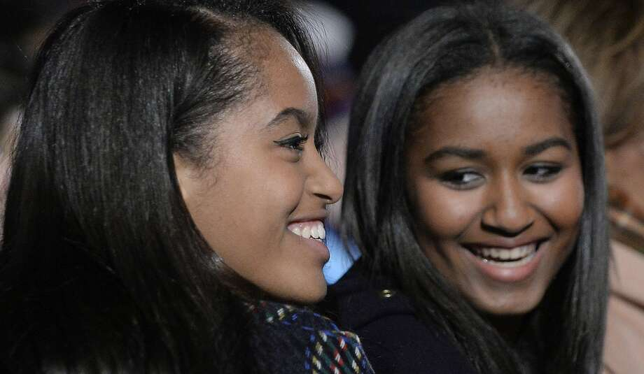 WASHINGTON, DC - DECEMBER 02:  Malia and Sasha Obama attend the national Christmas tree lighting ceremony on the Ellipse south of the White House December 3, 2015 in Washington, DC. The lighting of the tree is an annual tradition attended by the president and the first family. (Photo by Olivier Douliery- Pool/Getty Images) Photo: Pool/Getty Images