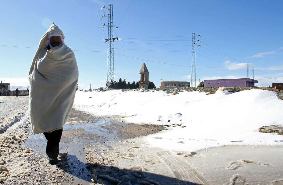 A Tunisian man walks in the snow in the town of Maktar in Tunisia's central Siliana region on January 16, 2017.  Heavy snow trapped around 1,000 motorists in northwest Tunisia, with heavy blizzards from Europe sweeping the Mediterranean country, the prime minister's office said Monday.   / AFP PHOTO / FAOUZI DRIDIFAOUZI DRIDI/AFP/Getty Images Photo: FAOUZI DRIDI, AFP/Getty Images